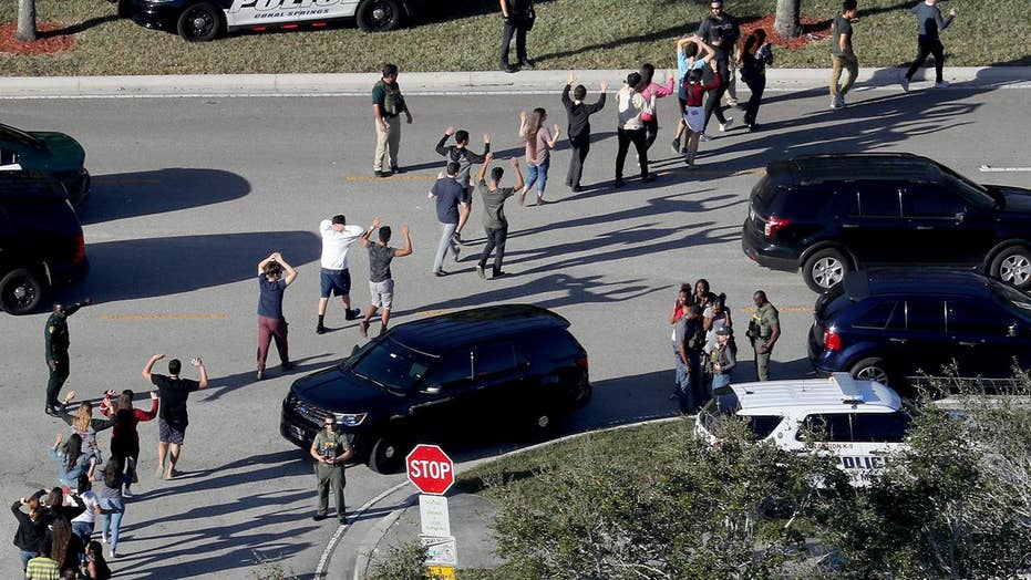 Former sheriff's deputy arrested over deadly school shooting in Parkland, Fla.
