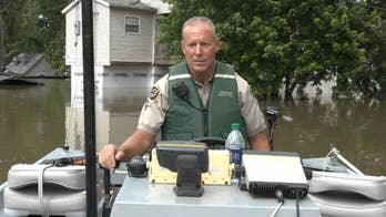 Police in Missouri patrol flooded streets in boats