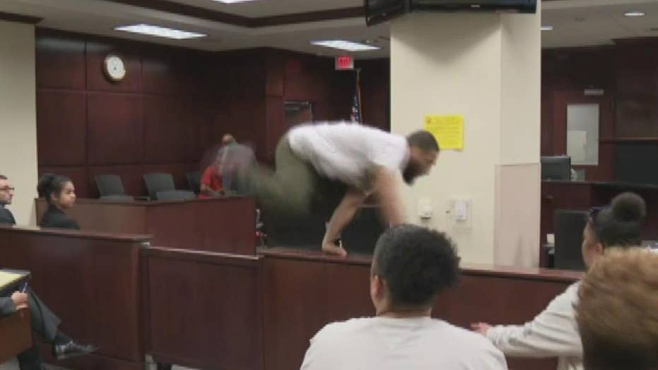Raw video: Son of murdered woman tries to attack suspected killer in court