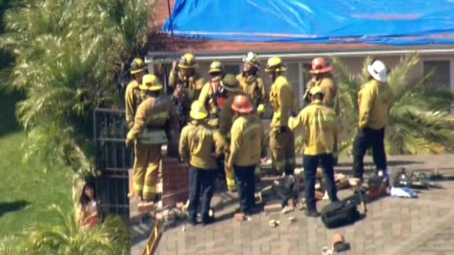 Raw video: Teenager rescued from chimney by LA County firefighters
