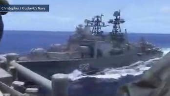 US Navy says Russian destroyer came with 50-feet of USS Chancellorsville in the Philippine Sea