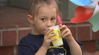 5-year-old cancer survivor sells lemonade to help other children who are battling cancer