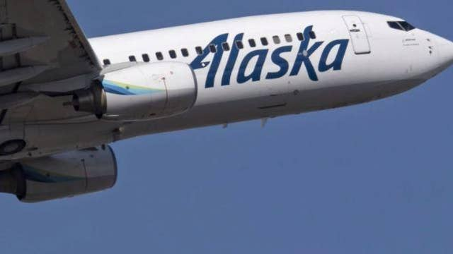 Alaska Airlines investigating incident after worker recorded hurling bags from plane