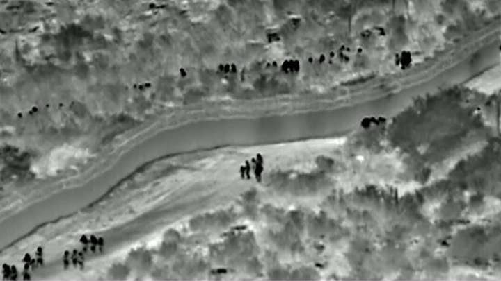 CBP releases video showing 134 migrants walking around an unfinished border fence