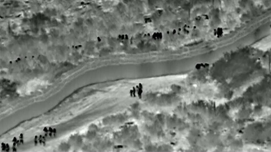 Kết quả hình ảnh cho Footage shows migrants walking around border wall to enter US