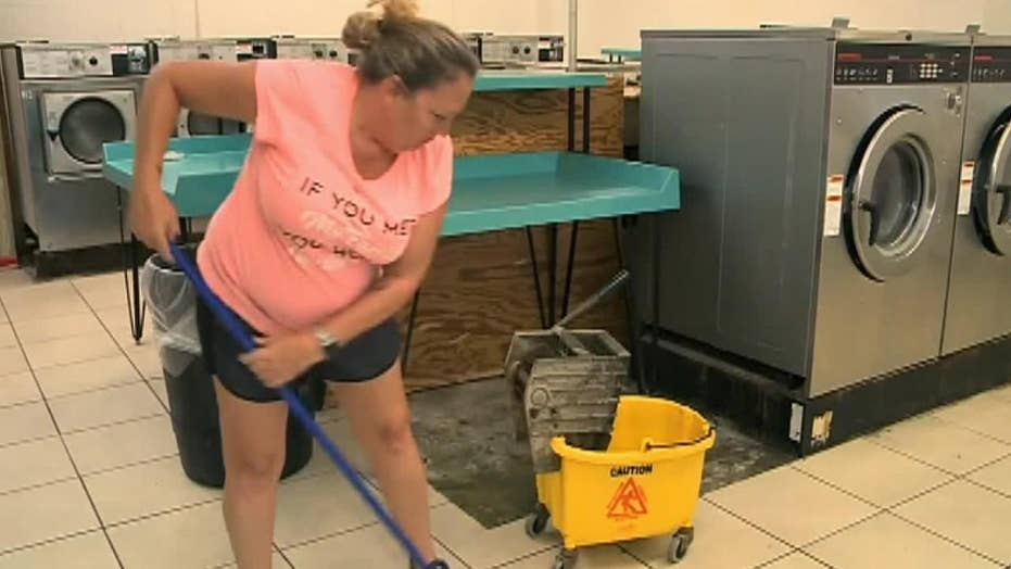 Mississippi laundromat attack after spat about washing machines caught on video