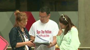 Asian Americans push back against identity politics in Washington state