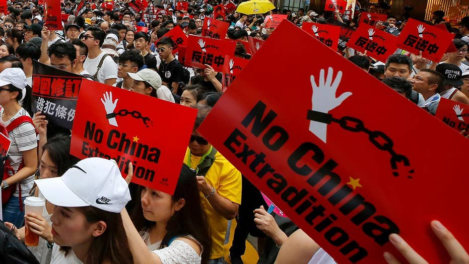 Massive protests in Hong Kong as crowds rally against China extradition bill