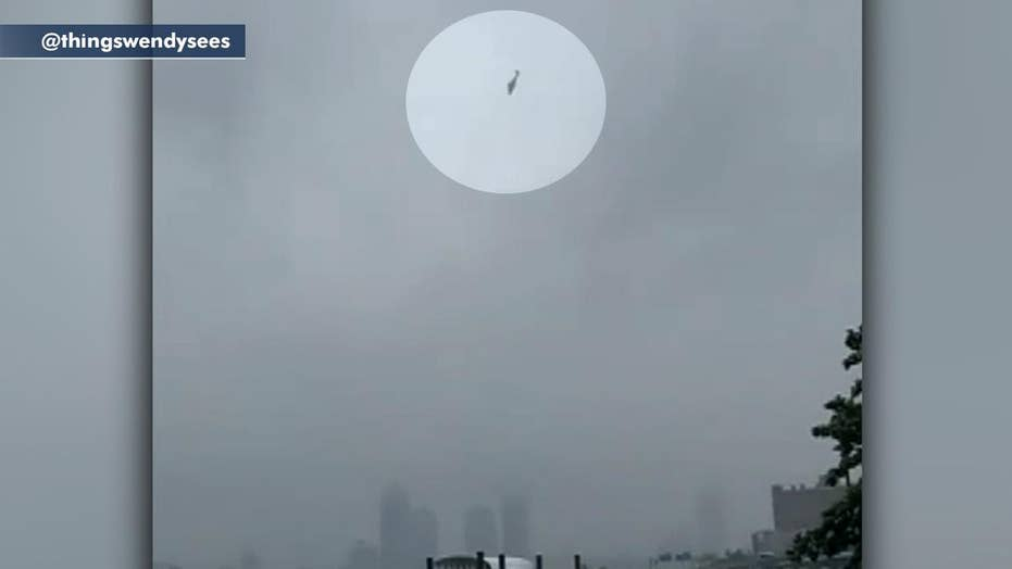 Helicopter seen flying erratically over the East River in New York City