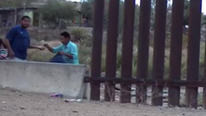 Footage of U.S.-Mexico border shows armed coyote smuggling dozens into the U.S.