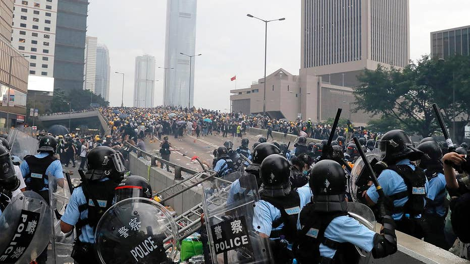 Thousands of demonstrators surround government buildings in Hong Kong, protest against extradition bill