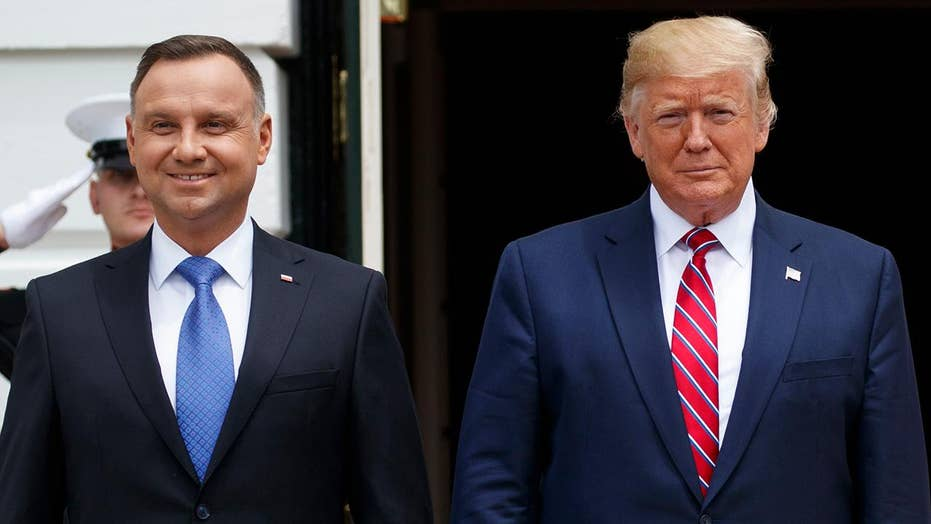 Trump participates in joint press conference with Polish President Duda