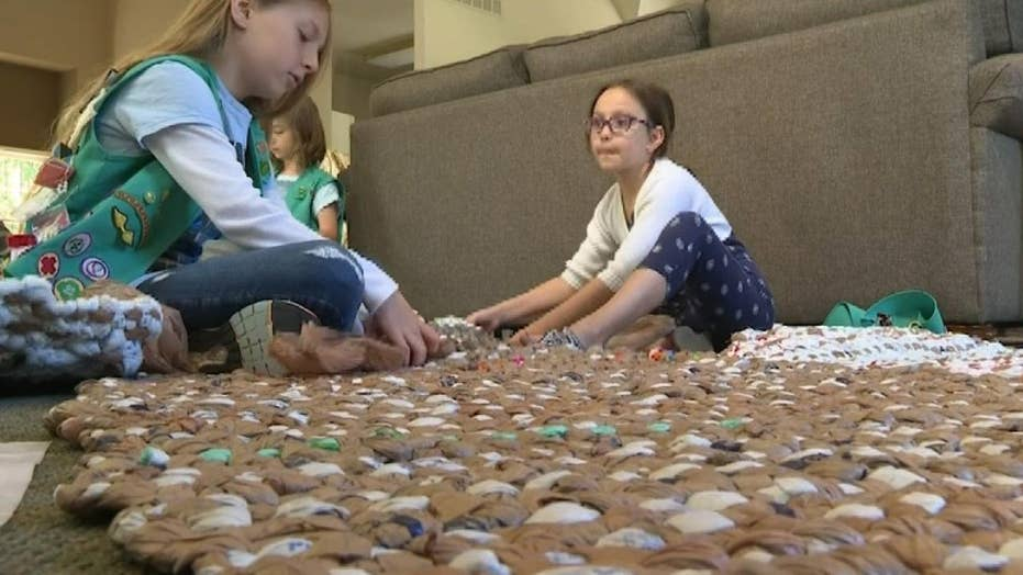 Girl Scouts in Georgia create eco-friendly sleeping mats for the homeless