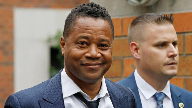 Cuba Gooding Jr. turns himself in to police after woman accuses him of groping her at New York City bar