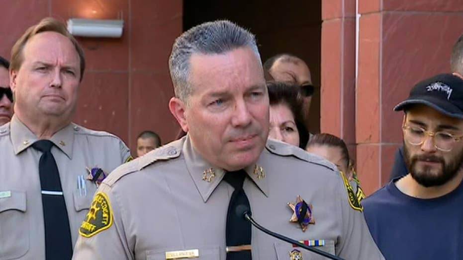 LA County Sheriff Alex Villanueva answers questions in a news conference on the shooting of a sheriff's deputy.