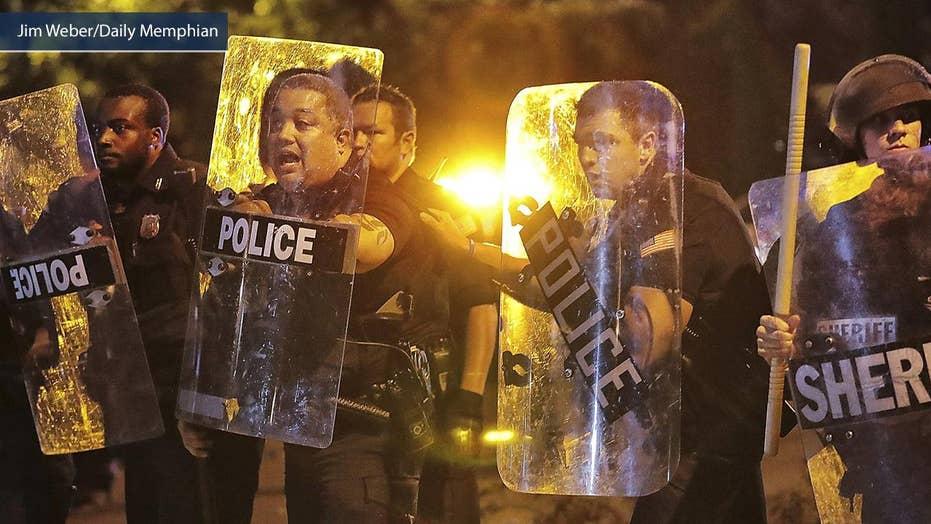 Demonstrators smashing cop car during violent riots in Memphis