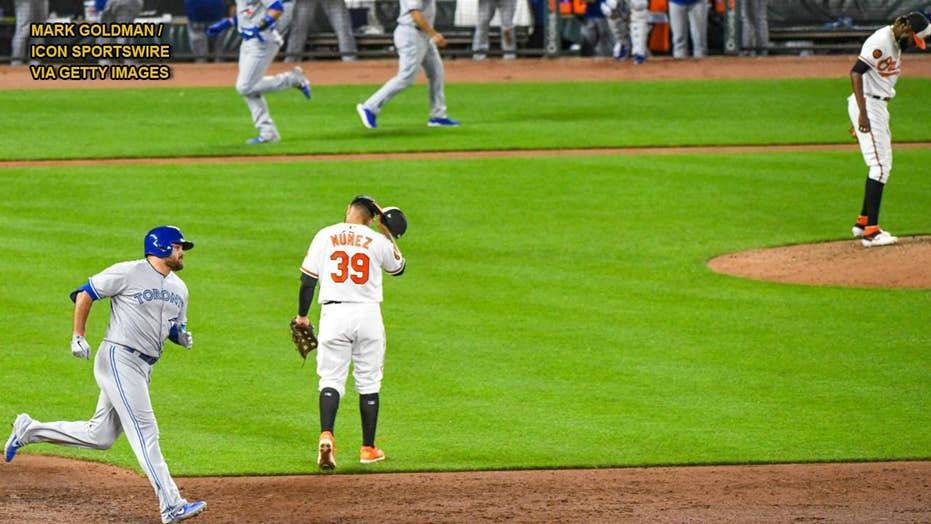 Baltimore Orioles fan grabs foul ball away from two youngsters