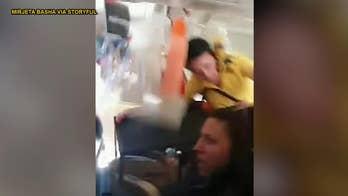 Video of severe turbulence shows flight attendant hitting plane ceiling