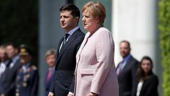 Angela Merkel seen visibly shaking while standing next to Ukraine's president; blames dehydration