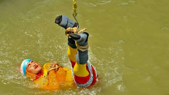 Body of Indian magician found in River Ganges 24 hours after 'Houdini' trick went wrong