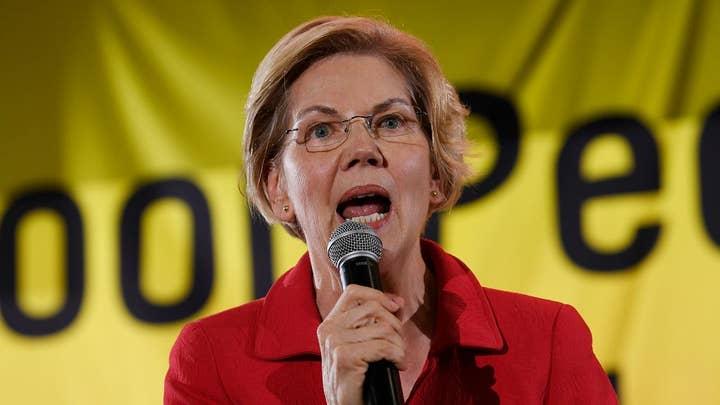 Warren employs grassroot approach amid Biden's fundraising success