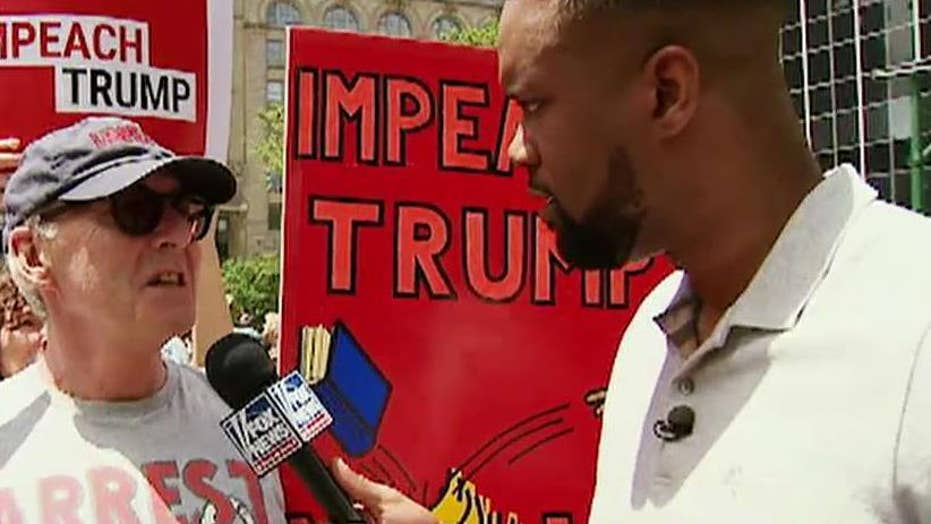 Lawrence Jones attends an 'Impeach Trump' rally in NYC