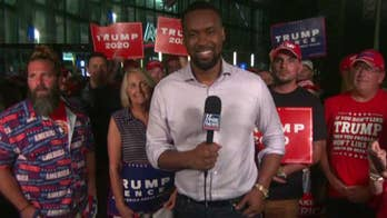Lawrence Jones speaks with Trump supporters outside Orlando rally