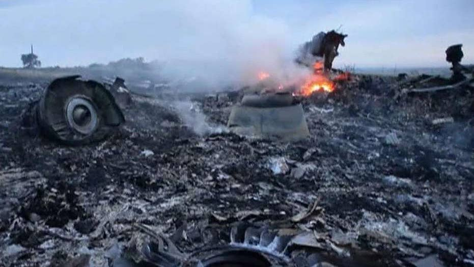 Three Russians, one Ukrainian charged with murder over downing of MH17 flight