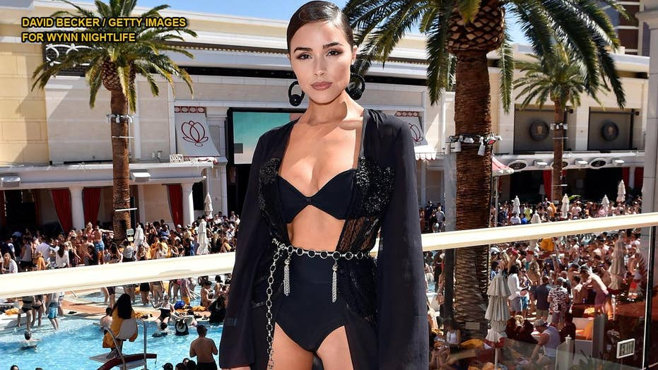 Olivia Culpo recalls posing topless with a snake for Sports Illustrated Swimsuit: 'I'm here to tell the tale'