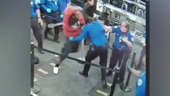 Footage from TSA attack at Phoenix airport shows suspect charging through checkpoint, punching officers