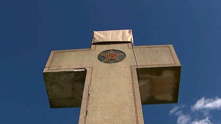 American Legion wins fight to keep peace cross memorial standing on public land