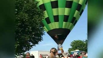 Hot air balloon flies through crowd at Missouri festival