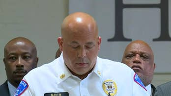 Police in Pine Lawn, Missouri brief the press on the fatal shooting of an officer