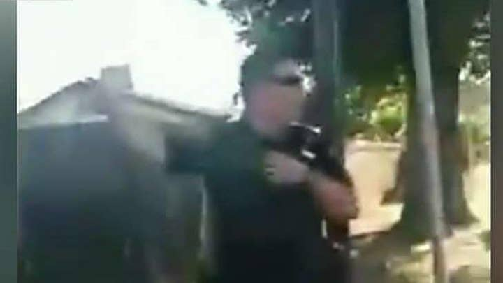 Hecklers taunt Sacramento police officers at scene of line-of-duty shooting that killed female rookie