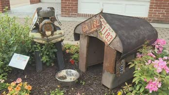 Artists honor junkyard dogs with sculptures crafted from junkyard trash