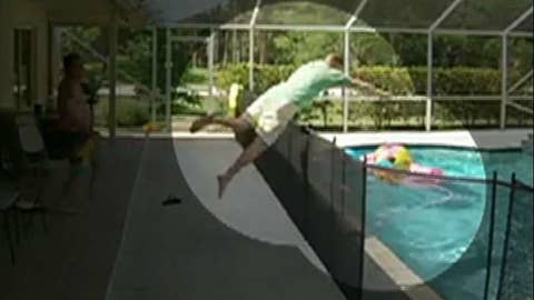 Dad dives over pool fence to save son from drowning