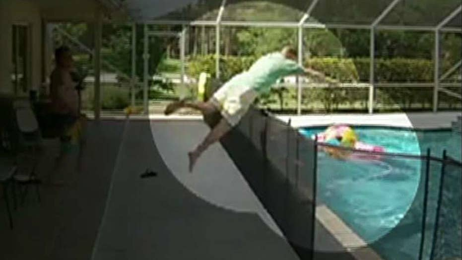 Florida dad dives over pool fence to save son from drowning