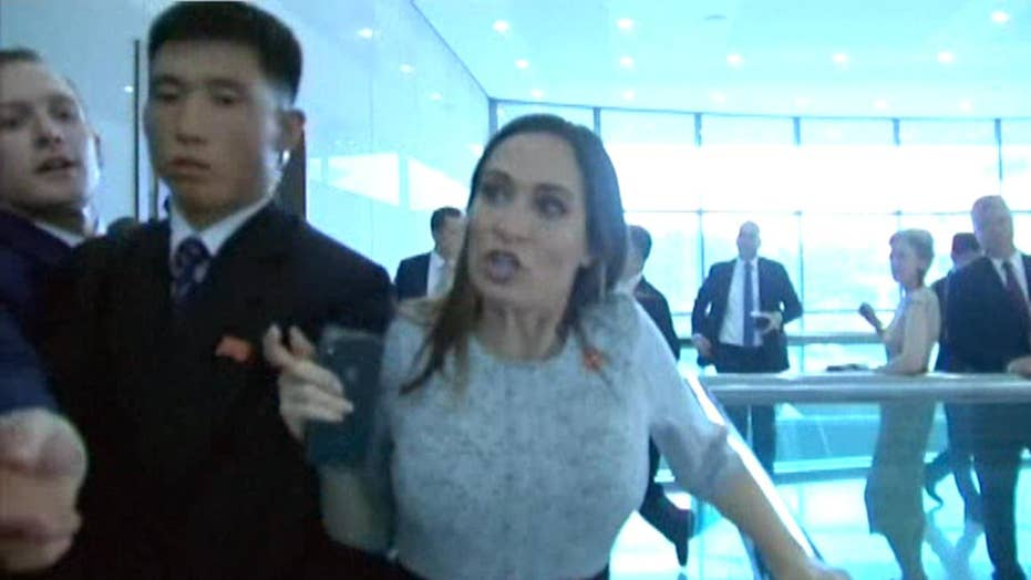 White House press secretary Stephanie Grisham caught in scuffle with North Korean guards