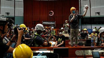 Pro-democracy activists storm government building in Hong Kong