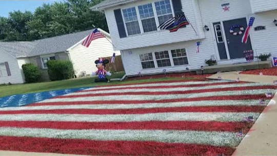 Illinois man paints giant American flag in front yard