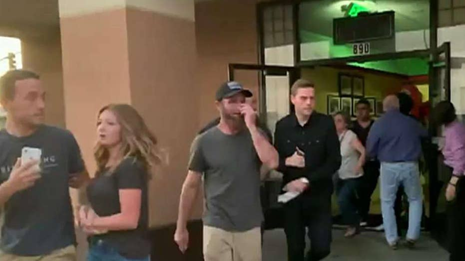 Panicked diners rush from a restaurant as a 7.1-magnitude earthquake hits Southern California