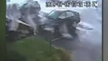 Tornado touches down in New Jersey, flips car and damages roof
