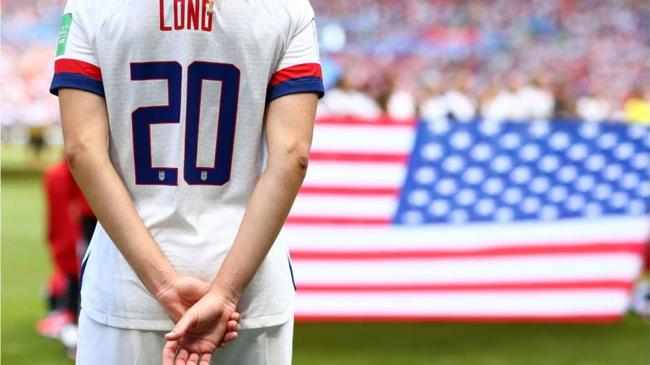 d8682e97b Allie Long briefly drops American flag, during World Cup celebration,  Kelley O'Hara