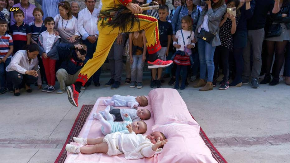 Story behind Spain's bizarre 'baby jumping' festival