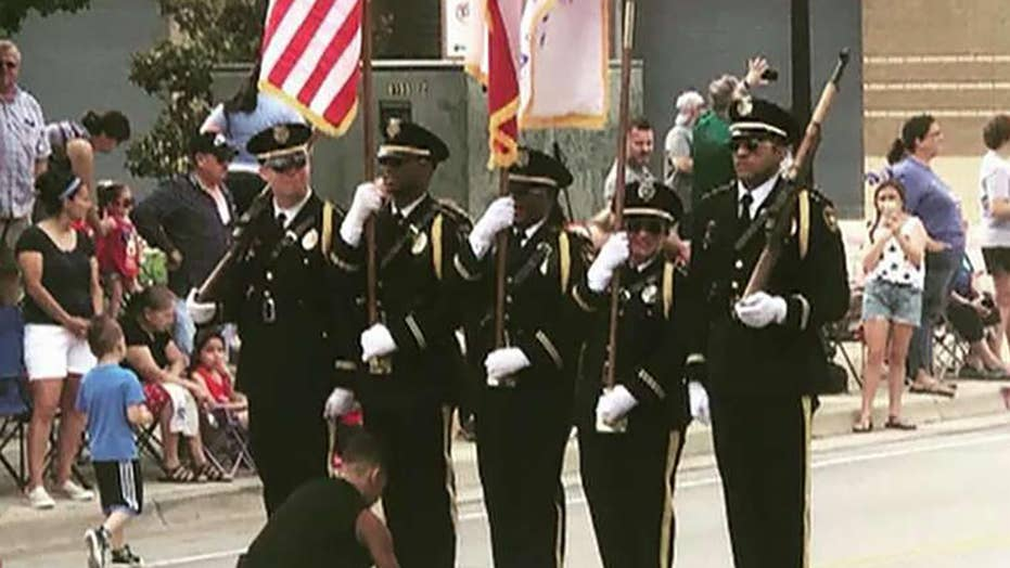 Boy steps in to tie honor guard's shoe during Texas Fourth of July parade