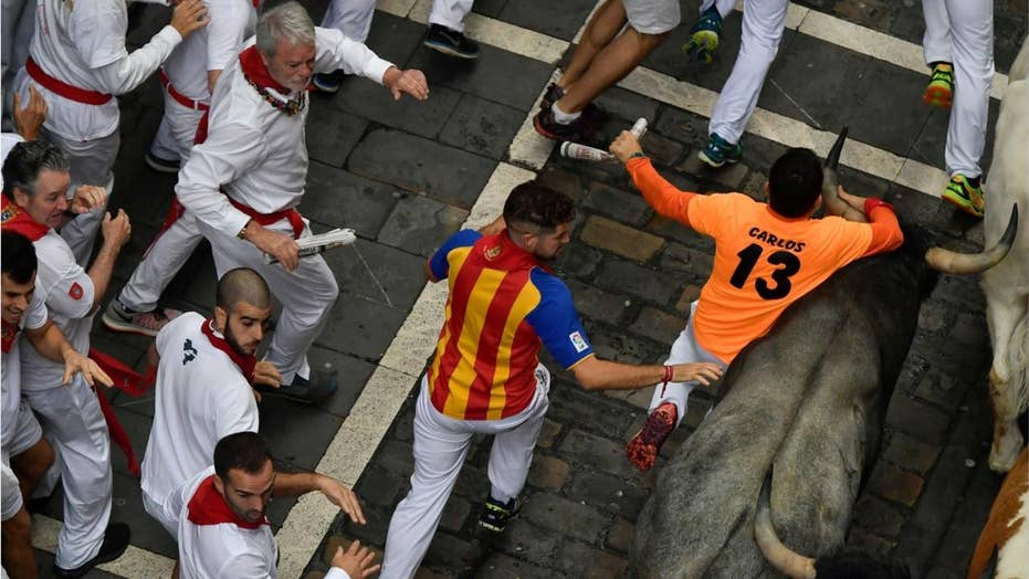 American man gored in the neck during Spain's running of the bulls said it felt 'like being hit by a car or a truck'
