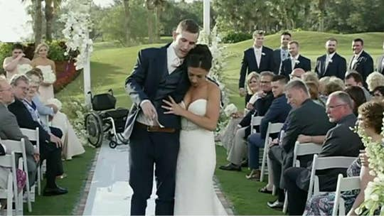 Paralyzed former football player who walked down the aisle shares inspiring journey: 'There's always hope'