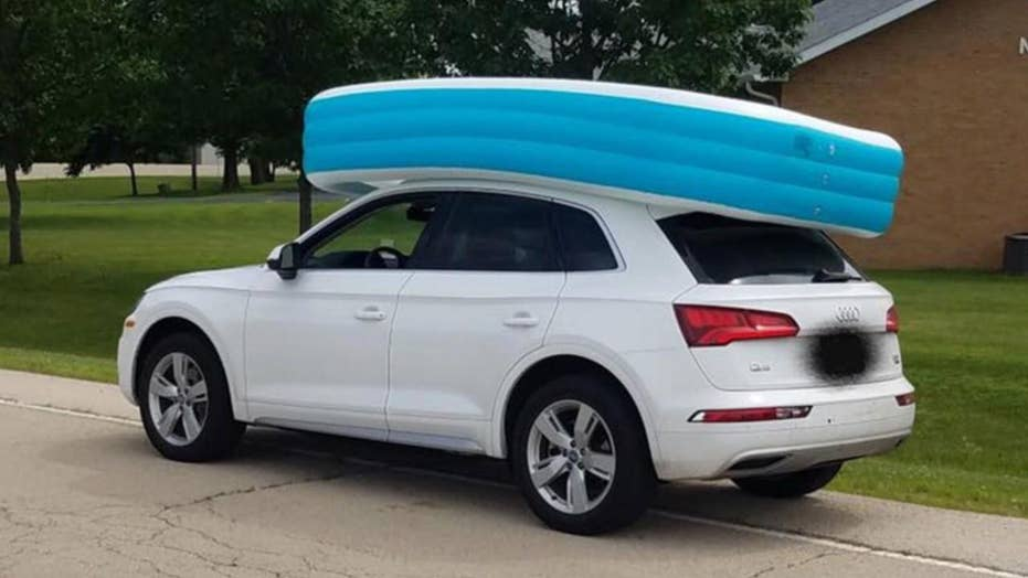 Mom held cruising with 2 kids roving in an inflatable pool on tip of her car