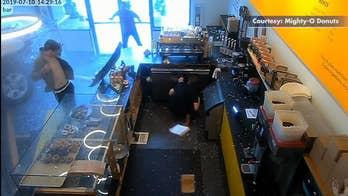 2 hospitalized following car crash into doughnut shop
