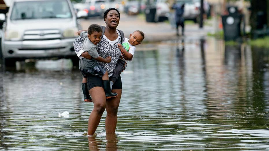 New Orleans bracing for prospect of a foot of rain as a Gulf system grows stronger